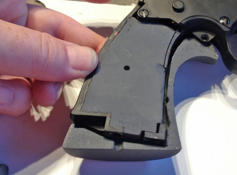 The cast plastic frame insert.