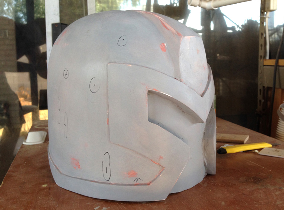 "Holding the helmet in strong light, I could see all the imperfections. I marked the low areas with a ""-"" and the high areas with a ""+"""