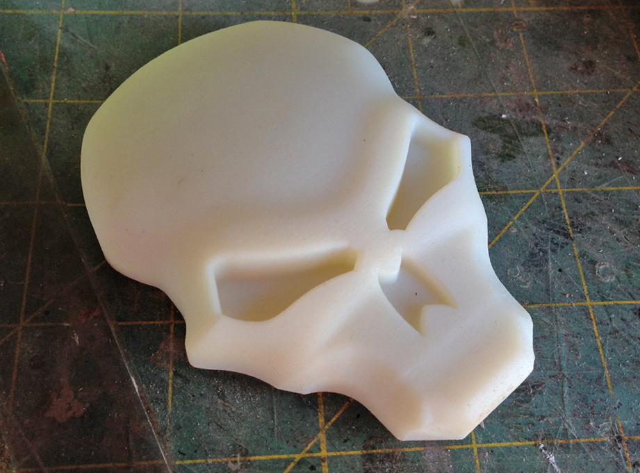 One of the clients had access to a super high-resolution 3D printer and sent me a copy of the skull emblem.
