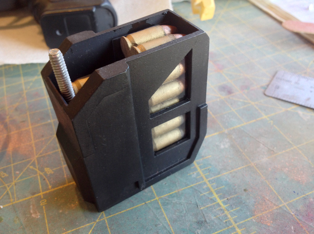 The front magazine loaded with the mounting bolt sitting behind the rounds.
