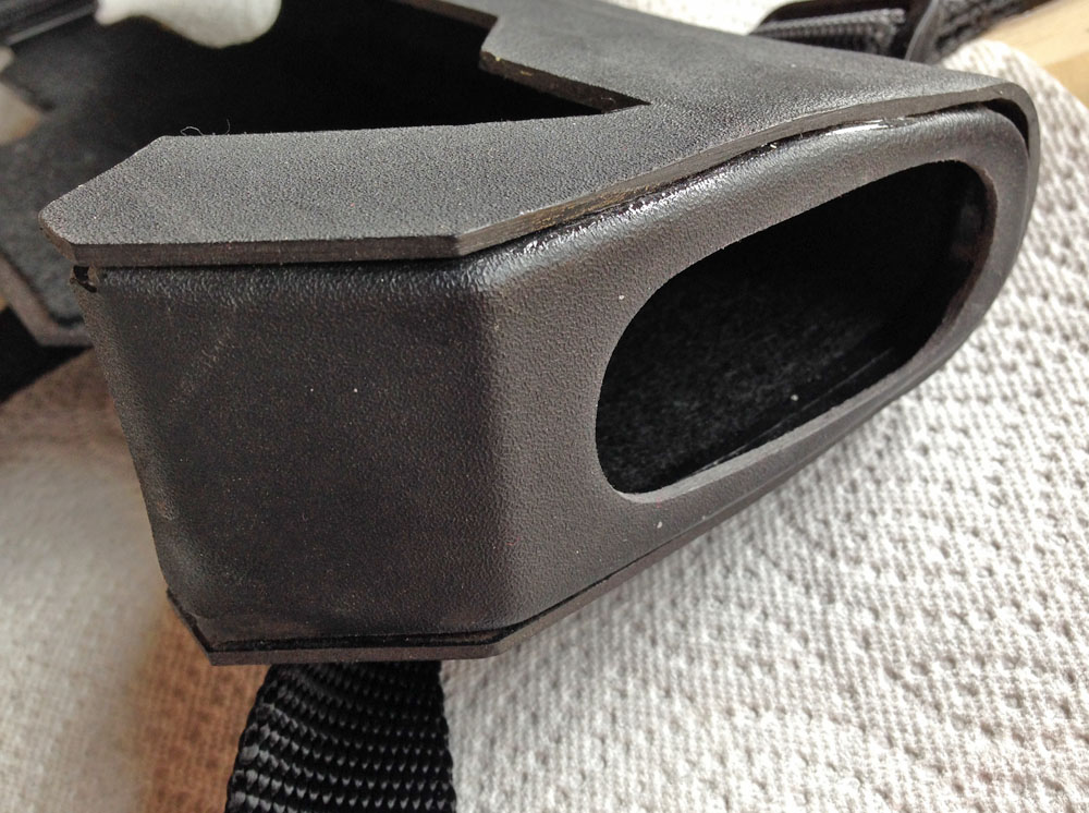 A second part was formed and glued into the tip of the holster, holding together two of the sides and keeping the gun from sliding out the bottom.