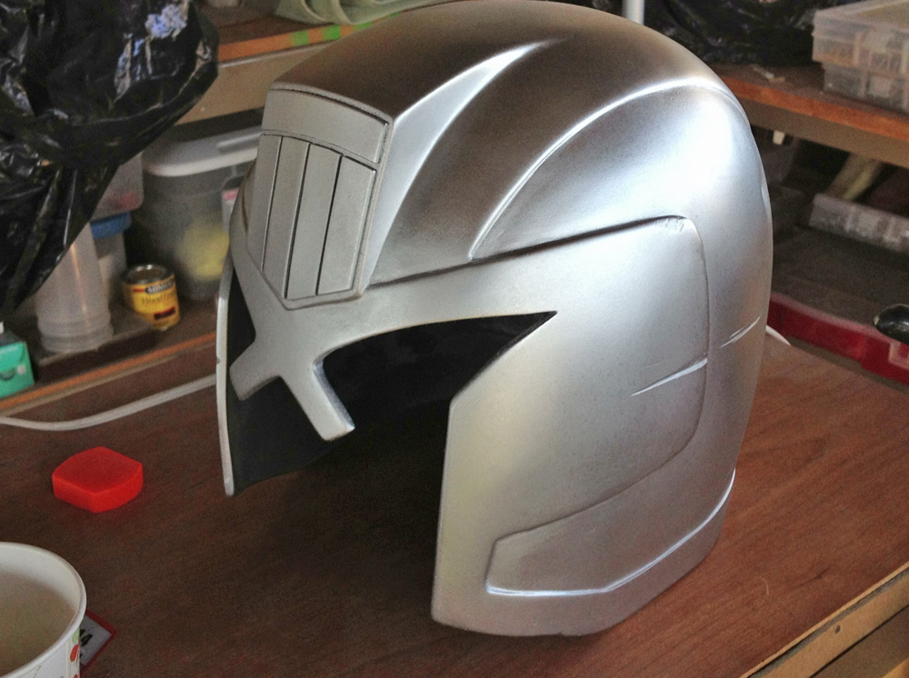 I applied a base coat of silver so that scuffing would reveal a different color under the paint job.