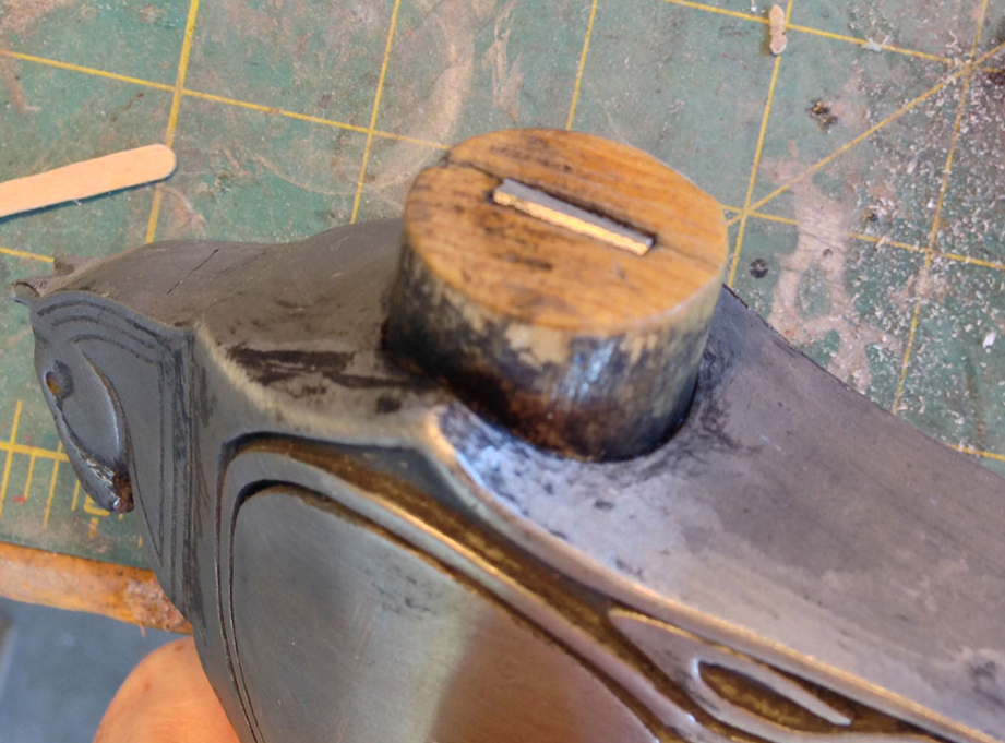 The wedge tapped into place (no glue needed) and some more weathering to blend it in.