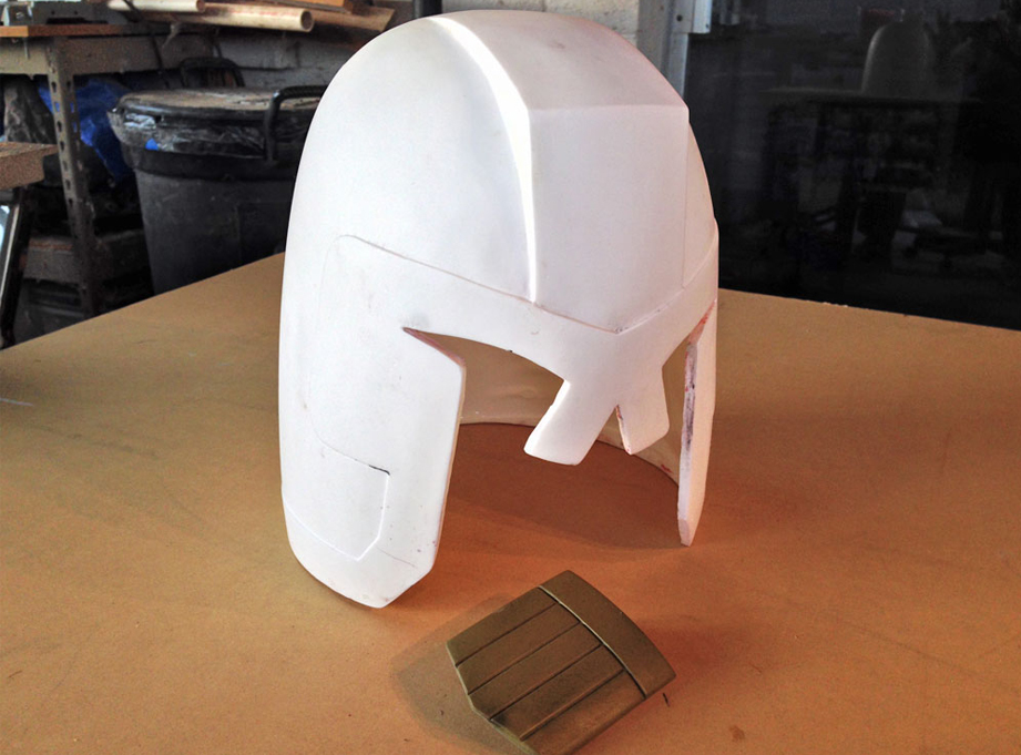 I rotocast the helmet with SmoothCast 300. The shield was cold cast with 300 and brass powder.