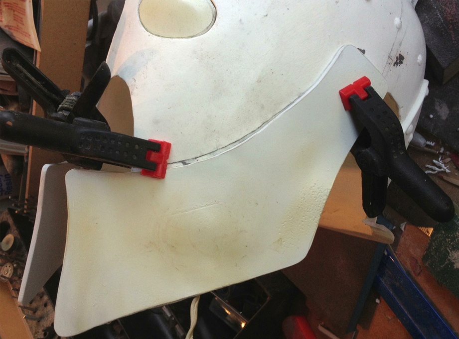 To make cheek guards, I cut thick styrene and heat formed it to fit snugly against the helmet.