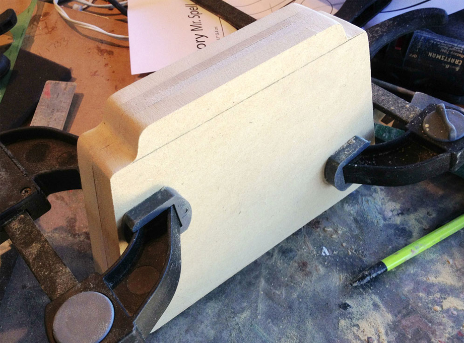 I glued the 3/4″ and 1/4″ pieces together to make two halves. Clamping both sides allowed me to sand the edges to make the fit perfect.