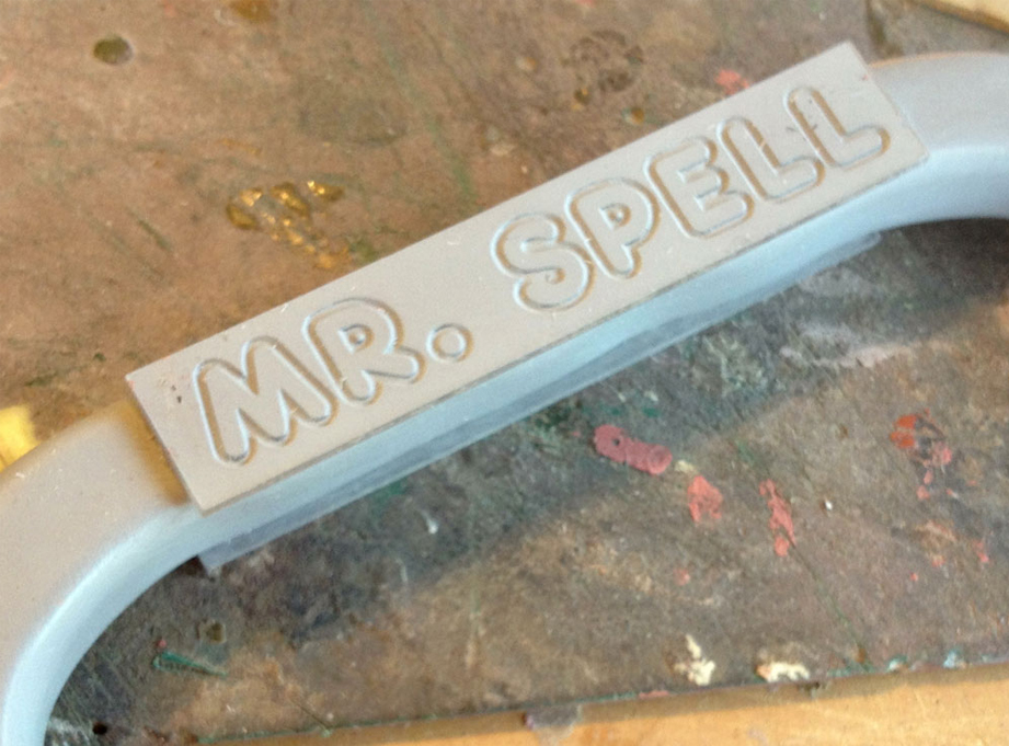 To make the engraved name plate on the handle, I had the letters cut into 1/8″ acrylic panels and glued them to both sides.