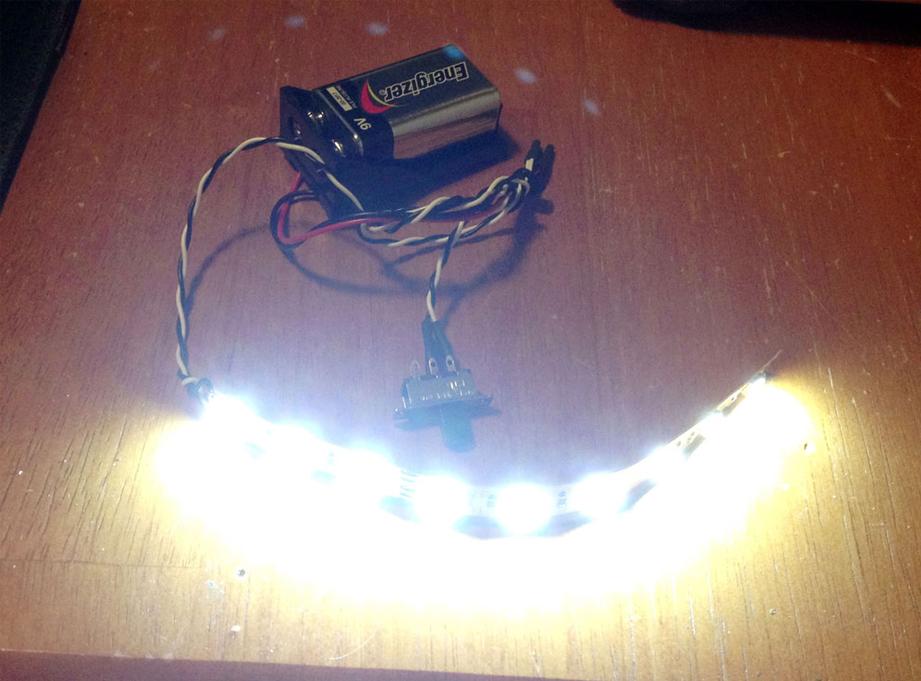 A 9v battery runs a bank of super bright LEDs on an adhesive strip!