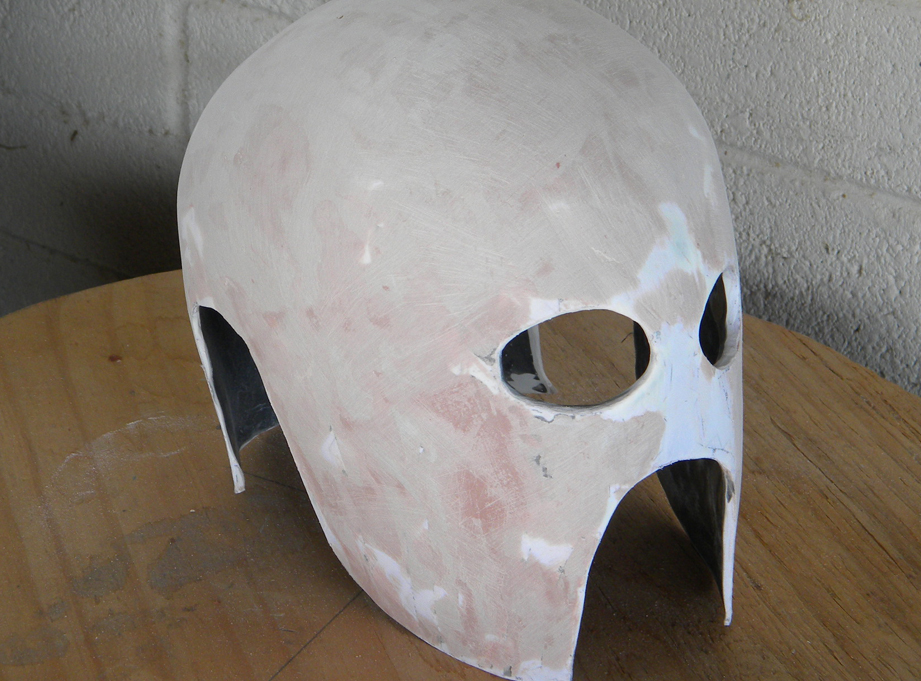 I sanded the ridges off the outside and used Bondo body filler to smooth out the surface.