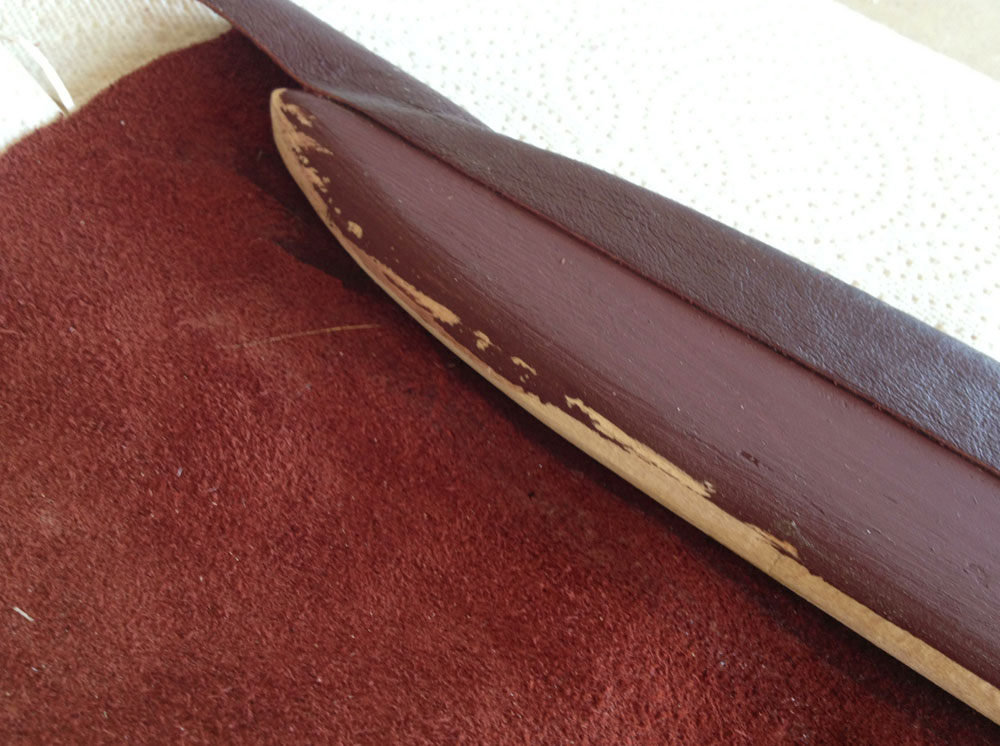 After a few failed attempts at stitching the leather on the scabbard, I decided to just glue it so that it would have a perfect seam. Just in case there was a gap in the seam, I pre-painted the wood a reddish brown to disguise the seam.