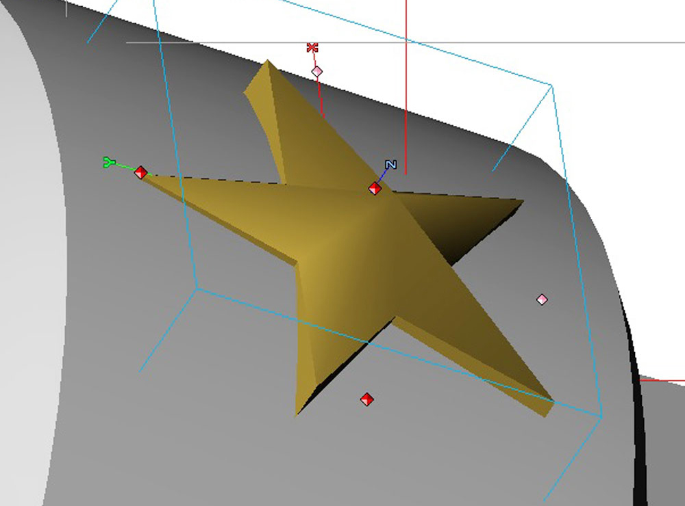 """Another issue was to distort the stars so they would wrap around the cuff. To figure out the geometry, I built the cuff in Strata 3D. As flat stars the """"arms"""" would poke out of the curved surface."""
