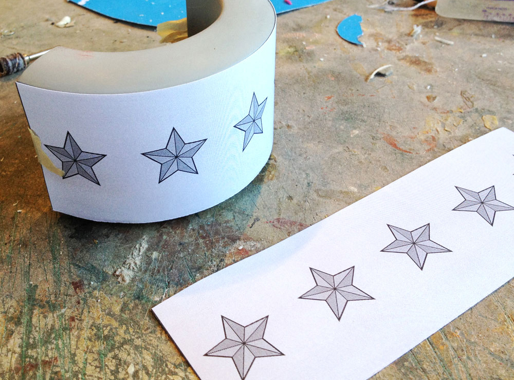 I printed out the star placement from my plans and wrapped it on the cuff, marking each star's location with small punctures of an Xacto knife.