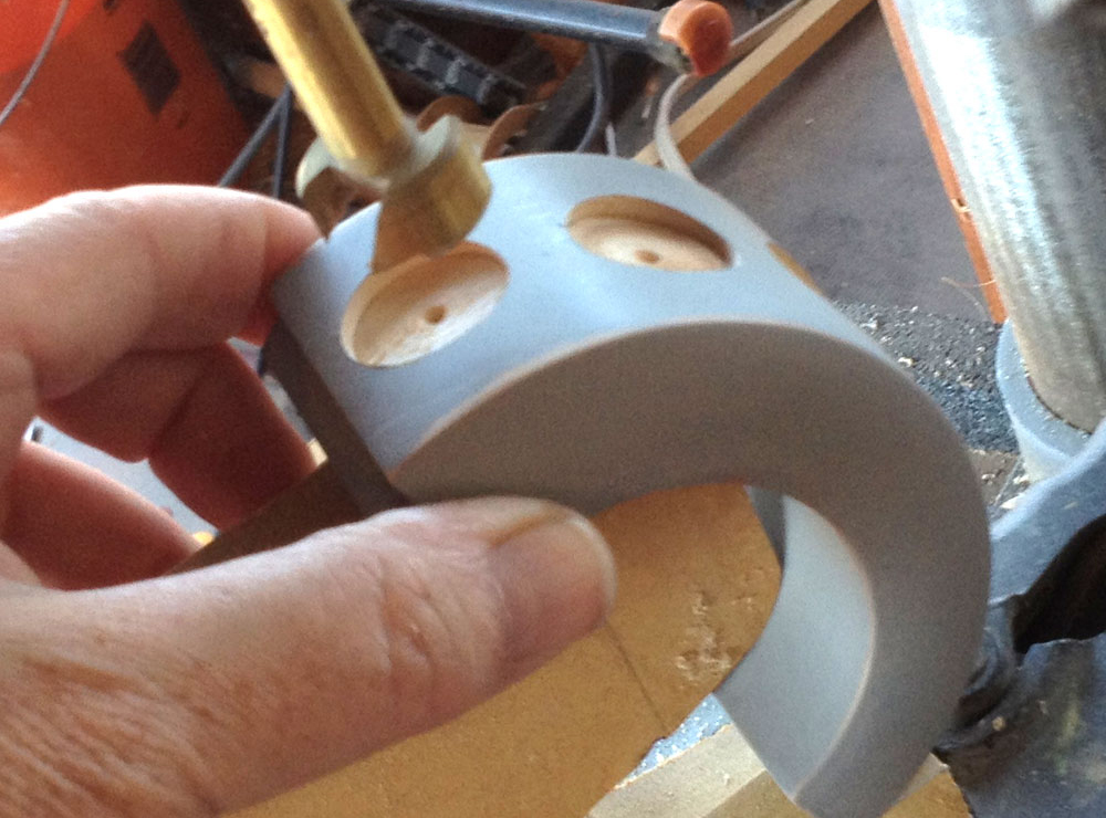 I drilled out holes in the cuff that were just big enough for the stamp to fit inside.