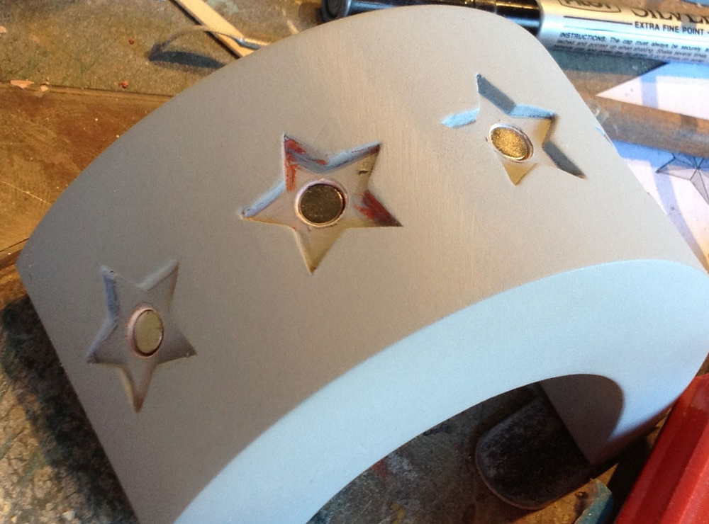 I drilled holes into each star recess to allow magnets.
