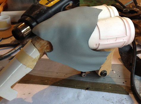 I heat formed thick styrene around the MDF of the pistol grip to make the cover.