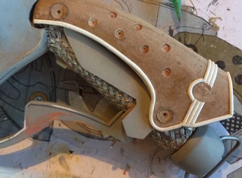 I drilled holes and added half round styrene piping to the outer grip.