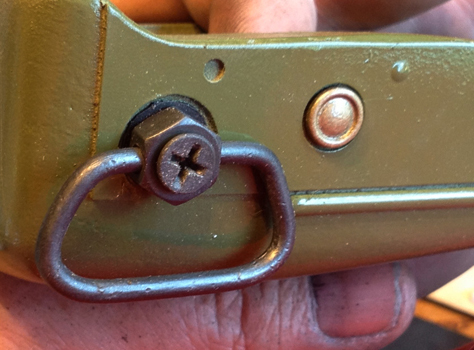 Here is a painted resin rivet glued onto the fore grip.