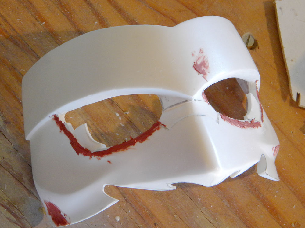 The half mask with excess cut away and the scribed lines filled with putty.