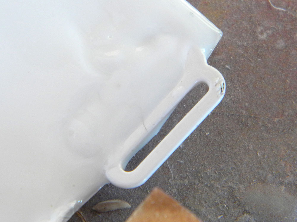 Tacking the hooks in place, I poured a small amount of resin in the corners to lock them in place.
