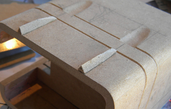 More MDF details for the sides of the cowl. The pockets were made with the Dremel sanding drum and a steady hand.