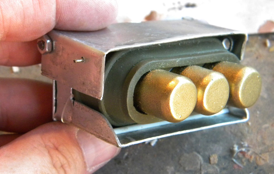 The battery seated in the holder.