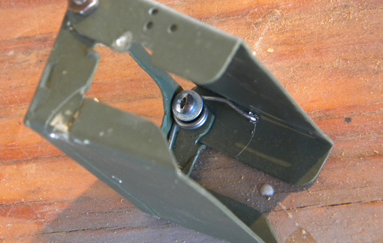 The holder was hinged at the top and equipped with a spring to grip the battery.