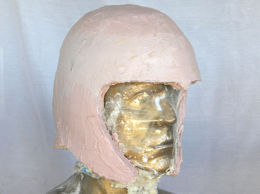 I applied a coat of Bondo over the entire helmet to prep the final surface.