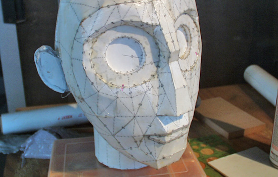 I sealed the paper with a coat of fiberglass resin. The screw at the base of the neck would be made separately.