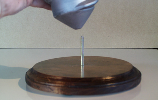 The secret of the stand…a nail is glued into the base that fits into a hole in the screw.