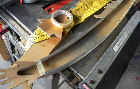 I made the scabbard out of MDF with 1/4″ poplar fins