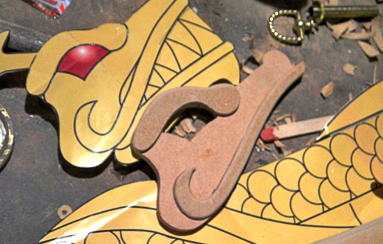 I cut parts for the face out of 1/4″ and 1/8″ MDF.