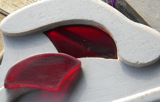 I cut eyes from 1/4″ red acrylic that fit into the eye socket.