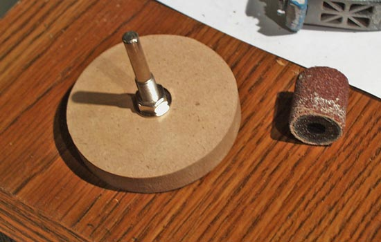 Since the lathe was occupied, I attached a disk of MDF to a drum sander attachment spindle.