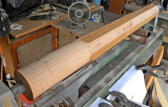 I used a 4″ x 4″ to make the shaft. Here I'm starting to knock off all the corners.