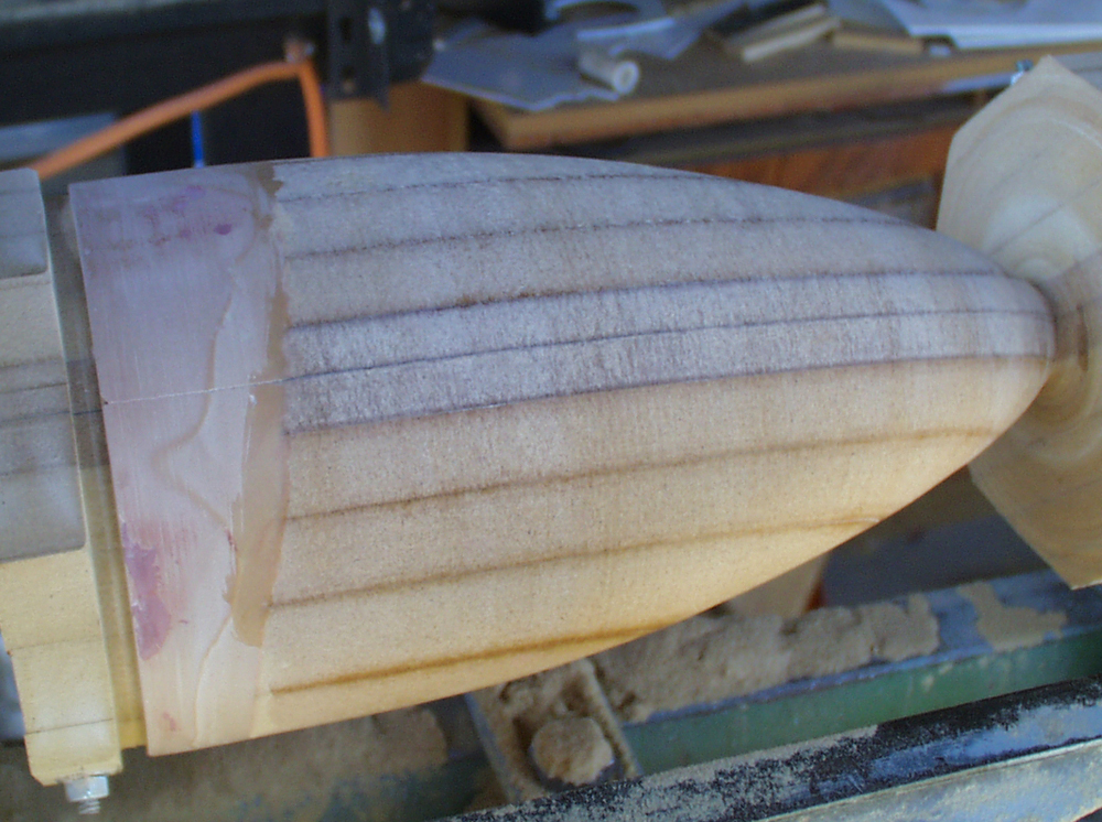 The cone starts to take shape after some work on the lathe. I took the opportunity to fix some gaps with Bondo.
