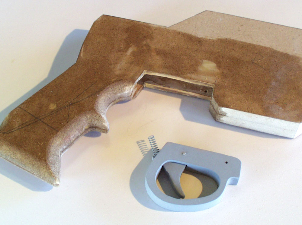 I used a router to carve out a recess for the trigger assembly. It will be glued in after painting.