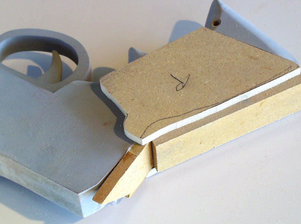 To make the grip plates, I used 1/4″ MDF to make a simple box around the pistol.