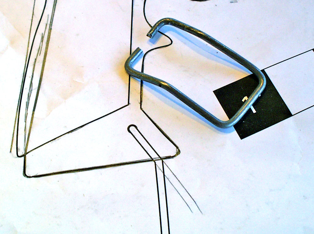 The lanyard loop was made by bending 1/16″ steel wire to shape.