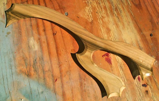 I started by cutting out the profile from a sheet of 1/4″ poplar. I used a Dremel tool to bevel the edges of the blade.