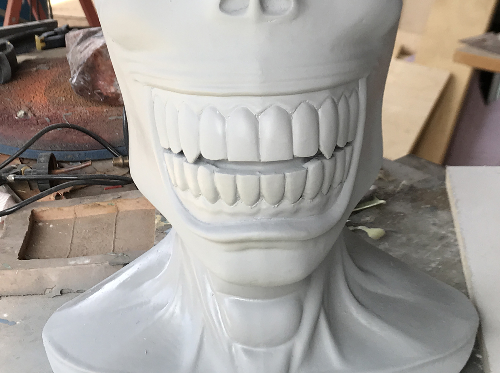 The downside is that it will fill in small detail as well so I think it's best used for organic shapes. I had to redefine the teeth, lips and gums before laying down a base coat of white with an Xacto blade