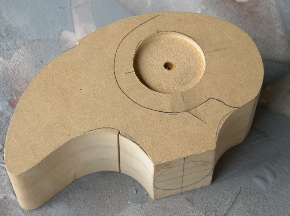 I was unsuccessful in building a model for the bird head so I decided to make my master from MDF.