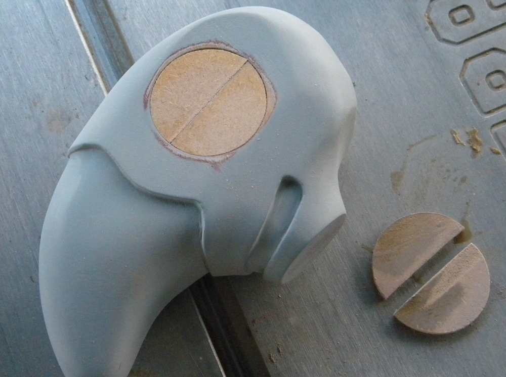 To attach the wings to the head and make sure they were straight, I cut 1/4″ MDF discs that would fit in the eye socket.