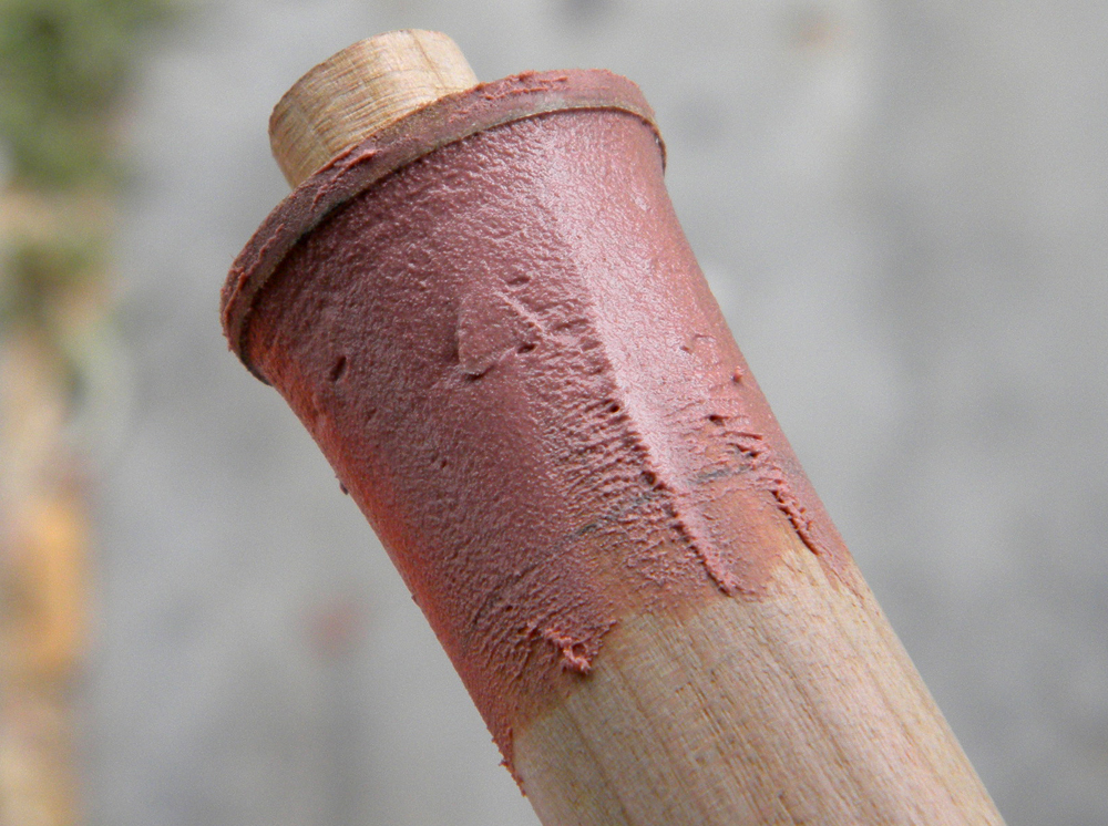 The staff was made from a 1″ oak dowel. I inserted a 1/2″ dowel in the end to attach the tip and flared both ends with Bondo, guided by a slightly larger MDF disc.