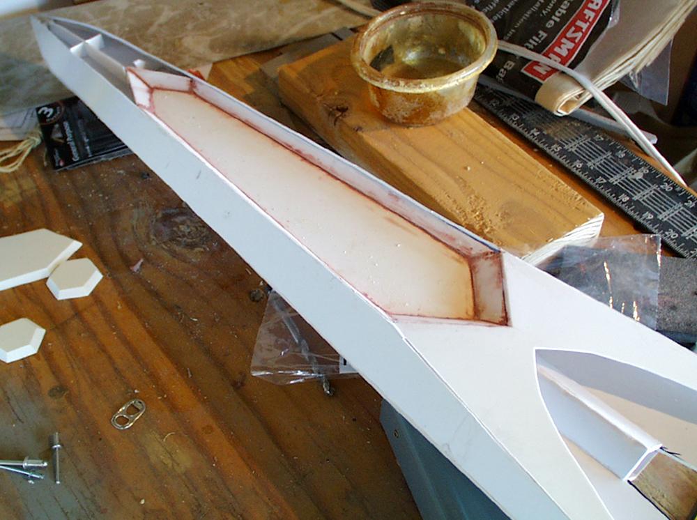 I glued styrene side panels to the head.