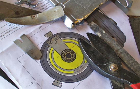 """I used tin snips to cut the metal """"tongue"""" out of an old hard drive sled."""