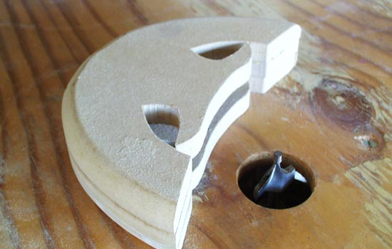 I glued three pieces of MDF to form the guard, leaving a channel for the blade. It was rounded on the router table.