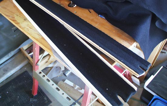 I glued black felt into the inside of the scabbard to protect the blade.