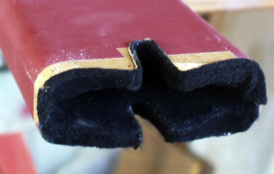I applied some extra felt on the top edge to protect the guard when it's put in the scabbard.