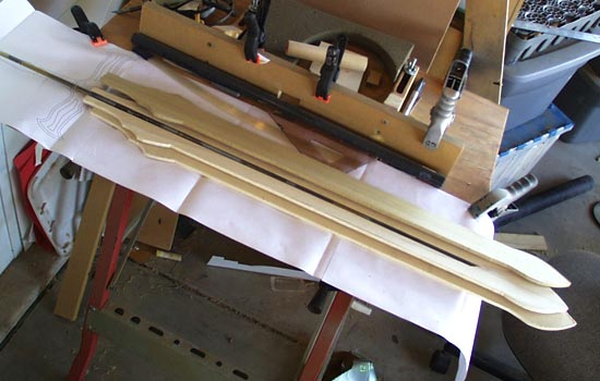 I started with a 5/16″ steel rod for a core. I cut a channel through a 1/4″ thick plank of poplar to contain it.