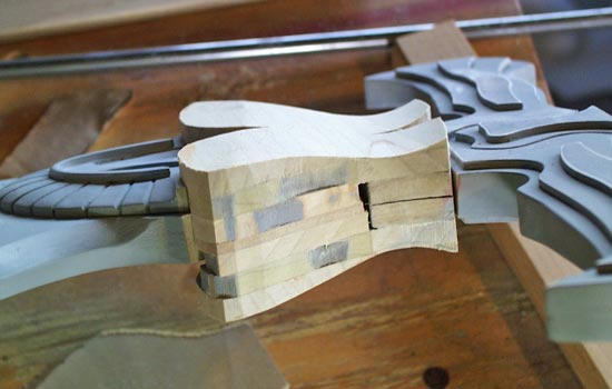 The blade cap was made with pieces of 1/4″ poplar glued together instead of MDF. I shaped it on the belt sander
